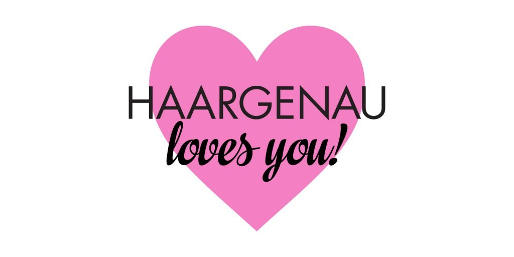 """Das Haargenau-Logo und der Text """"loves you!"""" sind auf einem Herz platziert"""
